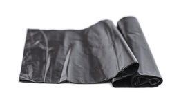 Черные пластичные мешки для мусора Стоковые Фотографии RF