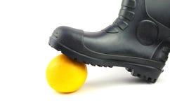 Черные резиновые ботинки с апельсином Стоковое Изображение RF