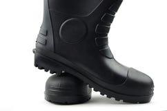 Черные резиновые ботинки Стоковое Изображение