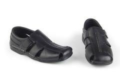 Черные сандалии кожи цвета Стоковое Фото