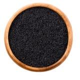 Черные семена тимона в деревянном шаре над белизной стоковое фото rf