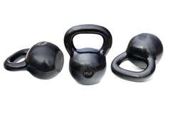 Черные сияющие тяжелые kettlebells Стоковая Фотография