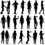 Черные силуэты красивого укомплектовывают личным составом и женщина на белом backgrou Стоковая Фотография