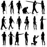 Черные силуэты красивого укомплектовывают личным составом и женщина на белом backgrou Стоковые Изображения