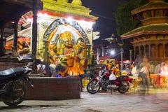 Черные статуя Bhairab и висок Krishna, квадрат Durbar, Катманду, Непал стоковые изображения