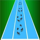Черные следы ноги с на текстурой дороги Стоковое Фото