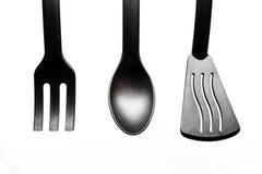 Черные утвари кухни на белой предпосылке Стоковая Фотография