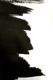 Черные ходы щетки на белой бумаге при одна изолированная рука Стоковая Фотография