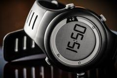 Черные цифровые наручные часы Стоковое Изображение
