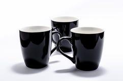 черные чашки Стоковая Фотография