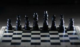 Черные шахматные фигуры на доске игры business concept images more my portfolio startegy стоковые фото