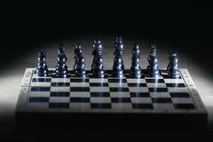 Черные шахматные фигуры на доске игры business concept images more my portfolio startegy стоковые изображения rf