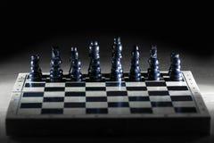 Черные шахматные фигуры на доске игры business concept images more my portfolio startegy стоковые фотографии rf