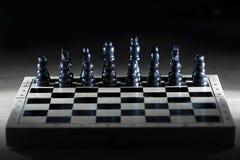 Черные шахматные фигуры на доске игры business concept images more my portfolio startegy стоковое фото
