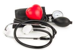 Черные tonometer и сердце стоковая фотография