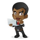 Черный бизнесмен держа компьтер-книжку Стоковое Фото