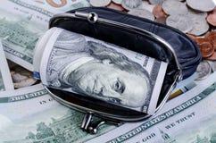 Черный бумажник с 100 долларами внутрь Стоковая Фотография