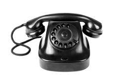 Черный винтажный телефон изолированный на белой предпосылке Стоковые Изображения RF