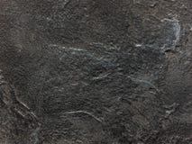 Черный декоративный гипсолит текстура Предпосылка Grunge Стоковые Фотографии RF