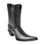 Черный заострённый ботинок ковбоя с заклепками стоковое изображение rf