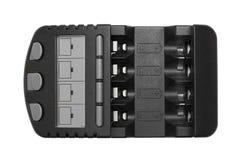 Черный заряжатель перезаряжаемые батареи изолированный на белой предпосылке Стоковая Фотография RF