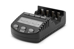 Черный заряжатель перезаряжаемые батареи изолированный на белой предпосылке Стоковое Фото