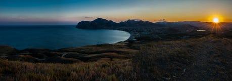 черный заход солнца моря Стоковые Изображения