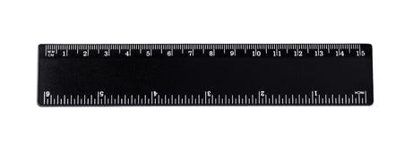 Черный изолированный правитель, дюймы, сантиметры стоковое фото rf
