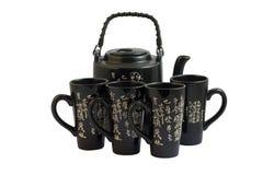 черный киец придает форму чашки чайник Стоковые Фотографии RF