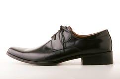 черный классицистический кожаный ботинок стоковые изображения