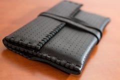 Черный кожаный мешок табака Стоковая Фотография
