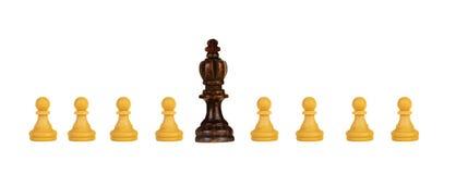 Черный король с белыми пешками стоковая фотография rf