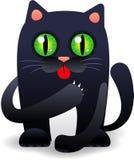 Черный кот лижа его лапку Стоковая Фотография