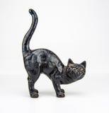 Черный кот против белизны Стоковые Изображения