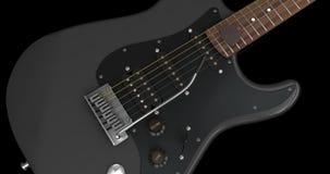 Черный крупный план электрической гитары Стоковые Изображения RF