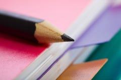 черный пинк карандаша тетради Стоковые Фото