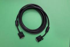 Черный свернутый спиралью кабель DVI Стоковое Изображение RF