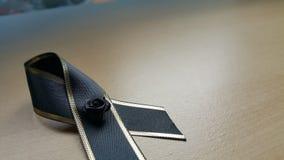 Черный смычок на деревянном поле Стоковое Фото