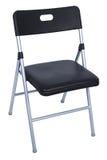 черный стул складывая над серебряной белизной Стоковые Изображения RF