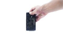 Черный сломанный телефон стоковое фото rf