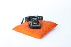 Черный телефон на белой предпосылке Стоковые Фото