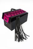 Черный хлыст фетиша в коробке на белизне Стоковые Изображения RF