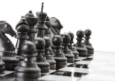 Черный шахмат на доске Стоковые Фото