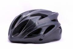 Черный шлем велосипеда на белой предпосылке Стоковое фото RF
