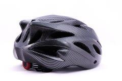 Черный шлем велосипеда на белой предпосылке Стоковое Фото