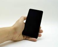 Черный smartphone в руке Стоковые Фотографии RF