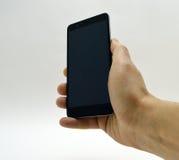 Черный smartphone в руке Стоковая Фотография