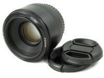 черным объектив крышки камеры изолированный dslr стоковые изображения
