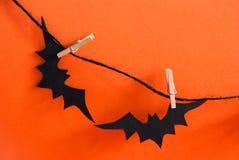 2 черных летучей мыши на линии Стоковые Изображения
