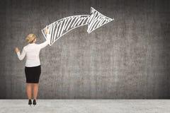 Чертеж бизнес-леди на стене Стоковая Фотография